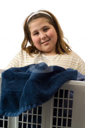 Daily Chores stock photo, A young girl carrying a laundry basket full of soiled towels by Richard Nelson