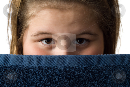 Girl With Bath Towel stock photo, Closeup view of a young girl looking over her bath towel, isolated against a white background by Richard Nelson