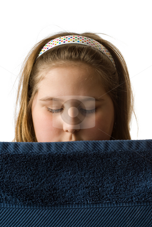 Bath Towel stock photo, A young girl looking over a bath towel, isolated against a white background by Richard Nelson