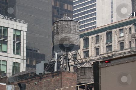 City Water Tower stock photo, A water tank above a building in NYC by Todd Arena