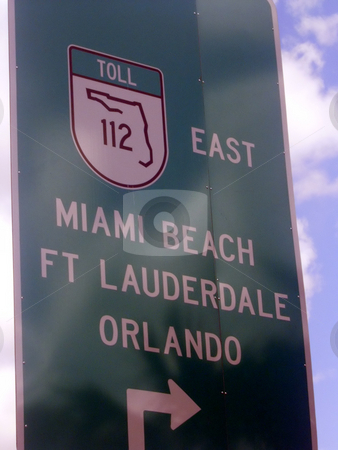 Miami Beach Sign stock photo, A sign for Miami Beach on the highway. by Todd Arena