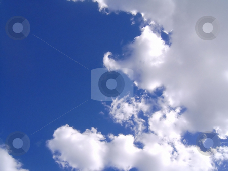 Marshmallow Clouds stock photo, A beautiful bunch of clouds rolling by at the beach. by Todd Arena