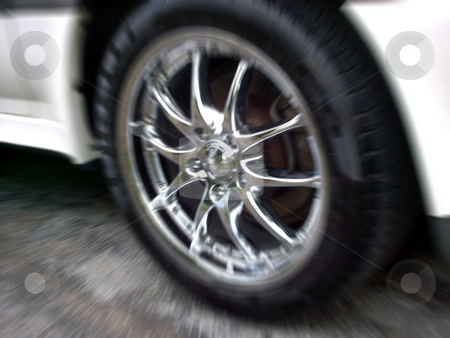Chrome Rims stock photo, A chrome wheel with a zoom blur effect. by Todd Arena