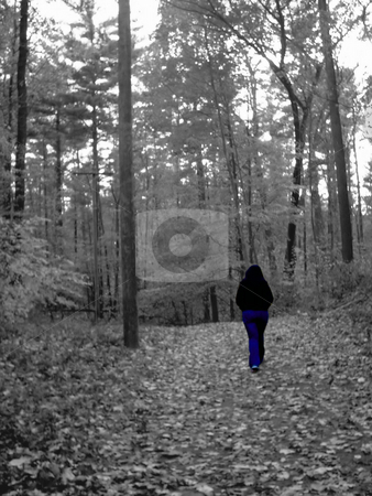 Walking In The Woods stock photo, The entire photo is in black and white, except for the girl that is walking. by Todd Arena