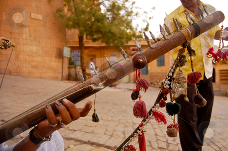 The indian ravanastron (captured in Jaisalmer, India) stock photo, Ravanastron or ravanatha is an Indian stringed instrument played with a bow, used by wandering pilgrims, particularly in Gujarat and (as in this case) Rajasthan... by Piero Biondo