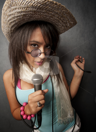 Beautiful Young Singer stock photo, Pretty young singer with a large microphone by Scott Griessel