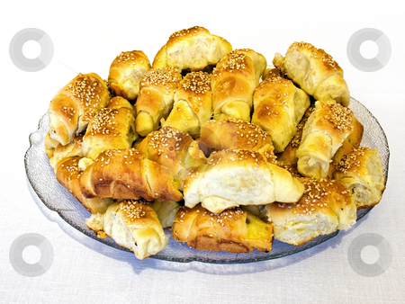 Croissants stock photo, Lot of salty croissants with cheese and sesame. by Sinisa Botas