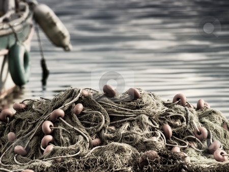 Net of fisherman stock photo, Fishing nets on the waterfront after fishing day. by Sinisa Botas