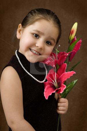 Formal Portrait stock photo, A formal portrait of a young child smiling and wearing some fancy clothing by Richard Nelson