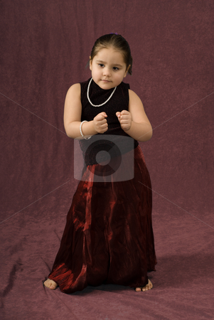 Dancing Child stock photo, A young child wearing a beautiful dress is dancing to the music by Richard Nelson