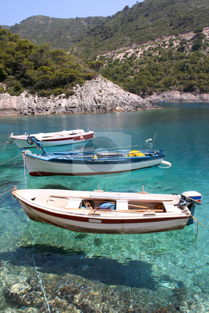 Three fishing boats stock photo, Small fishing boats anchored at Porto Vromi, Zante (Zakynthos) by Helen Shorey