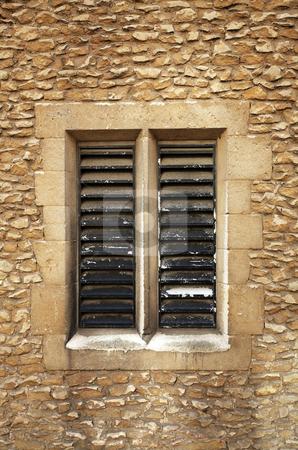 Slatted window in sandstone blocks stock photo, A slatted window in sandstone block setting from Cambridge UK by Mark Allchin