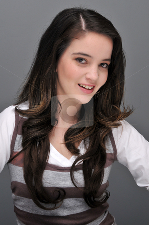 Brunette stock photo, Pretty young brunette in a striped pullover by Harris Shiffman