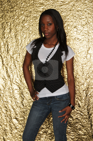 Vest & jeans stock photo, Dark skinned beauty in a pinstripe vest and jeans by Harris Shiffman