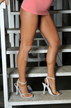 Legs stock photo, Long legs and a very short skirt on a stairway by Harris Shiffman