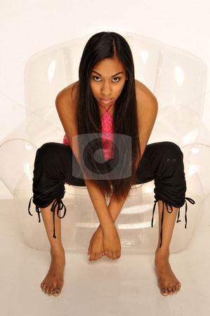 Long hair stock photo, Long haired, dark skinned beauty in an invisible chair by Harris Shiffman