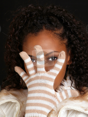 Young black woman with gloved hand before face stock photo, Young black woman with knitted glove hand before face by Jeff Cleveland