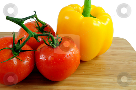 Tomatoes And Bell Pepper stock photo, Tomatoes And yellow Bell Pepper by Lynn Bendickson