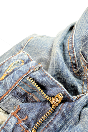 Zipper And Blue Pants stock photo, Brass zipper and blue denim jeans on light colored background by Lynn Bendickson