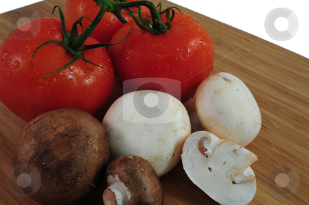 Tomatoes And Mushrooms stock photo, Tomatoes and Mushrooms on a cutting board by Lynn Bendickson