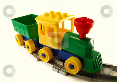 Toy Train  stock photo, Toy train made with building blocks on railway by ALESSANDRO TERMIGNONE