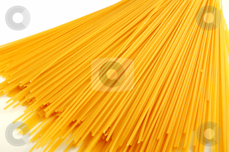 Dried spaghetti  stock photo, Dried spaghetti closeup over a white background by ALESSANDRO TERMIGNONE