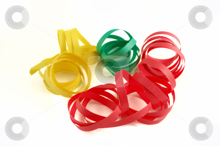 Party streamer stock photo, Green Red and yellow paper party streamer by ALESSANDRO TERMIGNONE