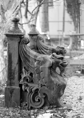 Griffins stock photo, An old bench with stone ornaments in the shape of two griffins by Mihai Zaharia
