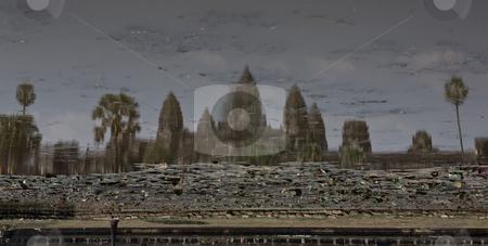 Upside down Ankor Wat reflection stock photo, Cloudy upside down reflection of Ankor Wat in a blue lake by Marius Blajut