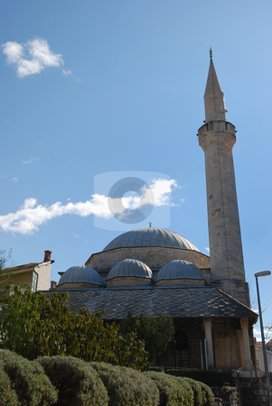 Karadjozbeg Mosque in Mostar stock photo, Karadjozbeg Mosque in Mostar, Bosnia and Herzegovina with blue sky in background. by Denis Radovanovic