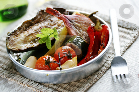 Spanish roasted vegetables stock photo, Oven-roasted summer vegetables with herbs by Liv Friis-Larsen