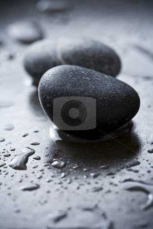 Rocks  stock photo, Two rocks on a dark surfface, sorounded by droplets of water by Liv Friis-Larsen