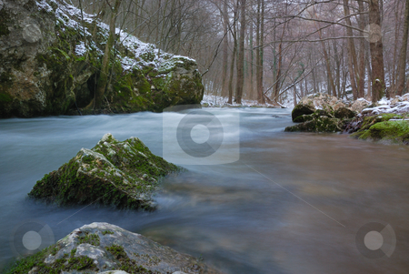 River in winter stock photo, Low angle view on a river in winter. by Ivan Paunovic