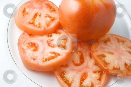 Tomato stock photo, Tomato sliced on saucer ready to serve or eat by Ira J Lyles Jr