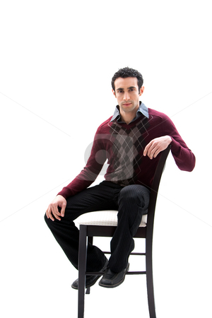Handsome guy sitting on chair stock photo, Handsome guy wearing business casual clothes sitting on a high chair, isolated by Paul Hakimata