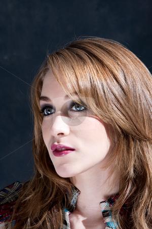 Beautiful dirty-blond woman stock photo, The face of a beautiful dirty-blond young woman with red lips and glossy smokey eyes, isolated by Paul Hakimata