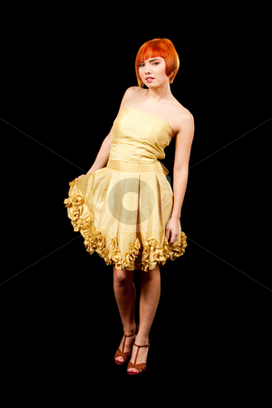 Redhead in yellow dress stock photo, Beautiful Caucasian redhead woman in yellow cocktail dress standing tilted, isolated by Paul Hakimata