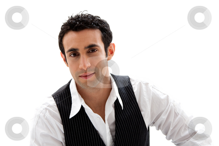 Handsome guy stock photo, Handsome male wearing a white shirt and black pinstripe vest, isolated by Paul Hakimata