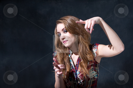 Cool dirty-blond stock photo, Cool rocker country girl with long dirty-blond hair and an attitude by Paul Hakimata
