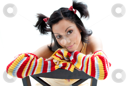 Fun girl stock photo, Beautiful fun latina girl with bright colored arm warmers and ponytails with red ribbons in her hair, isolated by Paul Hakimata