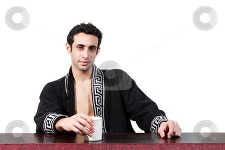 Morning guy drinking coffee stock photo, Handsome guy in the morning who just woke up sitting at a table in his robe with a cup, isolated on white by Paul Hakimata