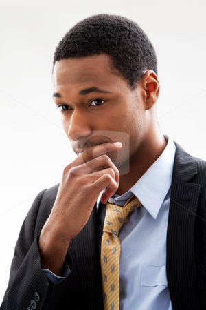 Handsome man stock photo, Handsome African American male in blue shirt and yellow tie and black pinstripe blazer, isolated by Paul Hakimata
