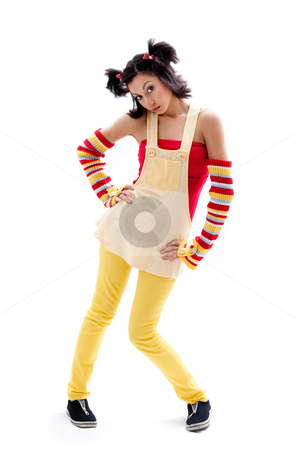 Fun girl standing stock photo, Beautiful fun latina girl with bright colored arm warmers and ponytails with red ribbons in her hair standing with hand on hips, isolated by Paul Hakimata