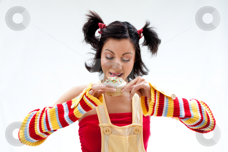 Cupcake girl stock photo, Beautiful Latina girl licking a cupcake, isolated by Paul Hakimata
