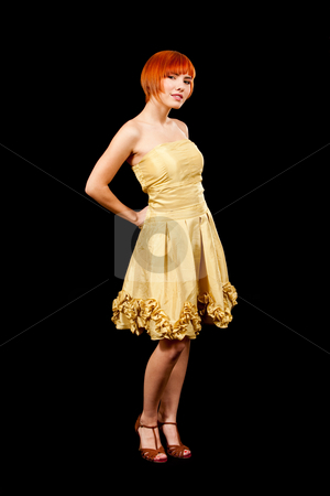 Redhead in yellow dress stock photo, Beautiful Caucasian redhead woman in yellow cocktail dress, isolated by Paul Hakimata