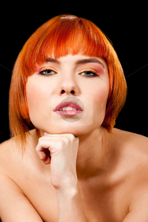 Beautiful redhead face stock photo, Face of a beautiful Caucasian redhead girl with fist under chin, isolated by Paul Hakimata