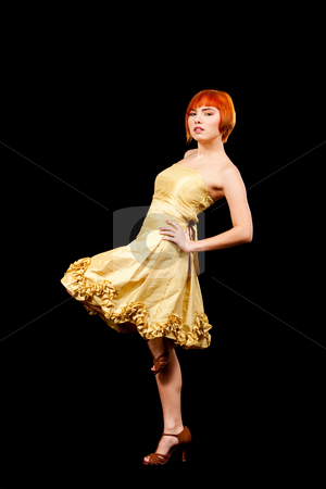 Redhead in yellow dress stock photo, Beautiful Caucasian redhead woman in yellow cocktail dress with one leg up, isolated by Paul Hakimata
