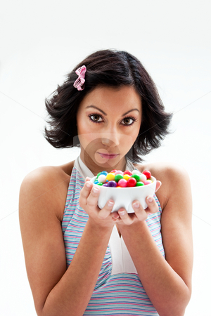 Happy candy girl stock photo, Happy beautiful candy girl with a bowl of colorful bubblegum candy balls, isolated by Paul Hakimata