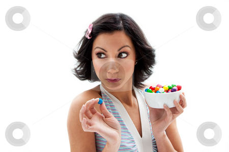 Happy candy girl stock photo, Happy beautiful candy girl looking to the side about to eat a bubblegum candy, isolated by Paul Hakimata