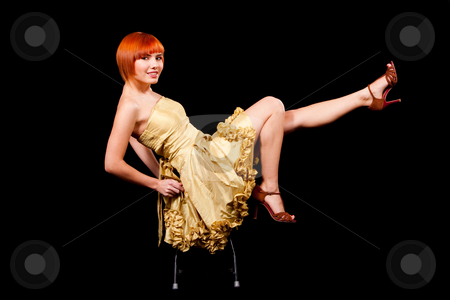 Sexy redhead in yellow dress stock photo, Beautiful sexy Caucasian redhead woman in yellow cocktail dress playful sitting on stool and legs up, isolated by Paul Hakimata